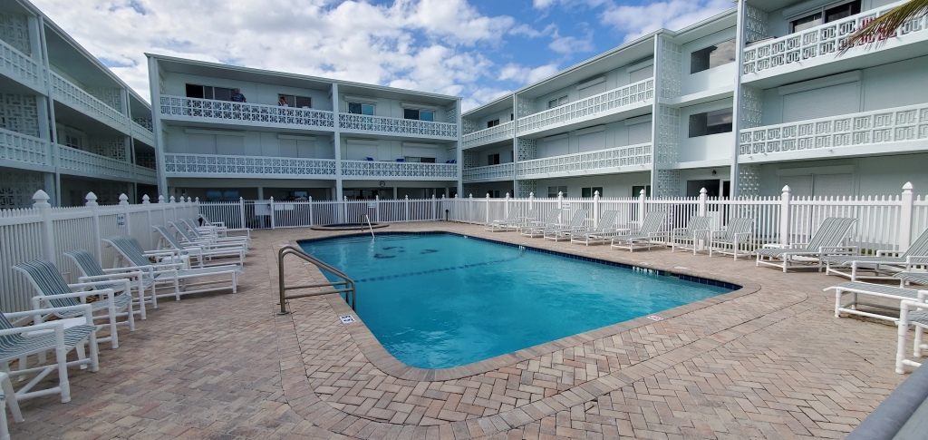 The Atlantique condo has a courtyard pool and balconies overlooking the pool.