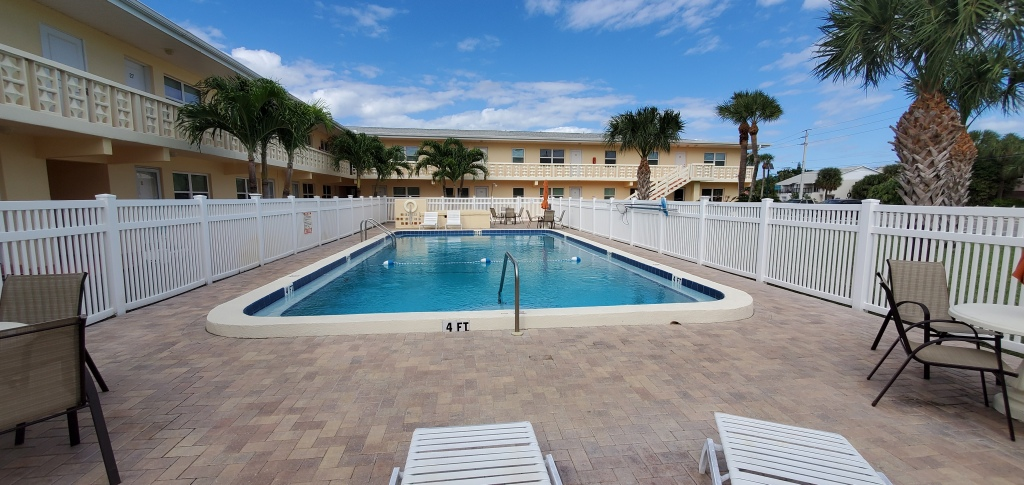 Pool view of the Morgan Manor condos in Cape Canaveral