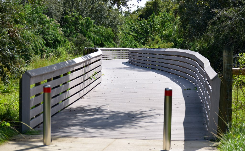 The boardwalk along the linear park at the Brevard Zoo