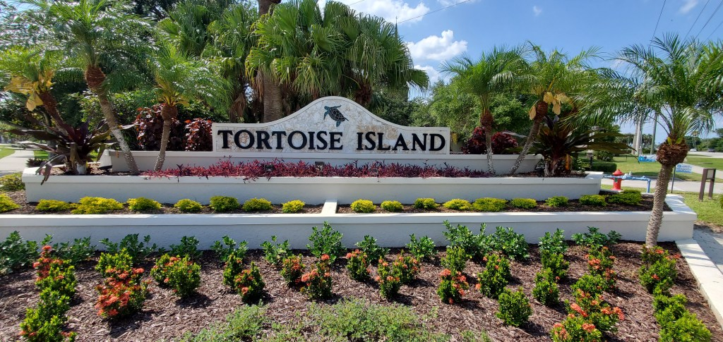 The entry to Tortoise Island in Satellite Beach. This development offers 24 hour guarded entry to the community and home options on the Banana River and on the Grand Canal.