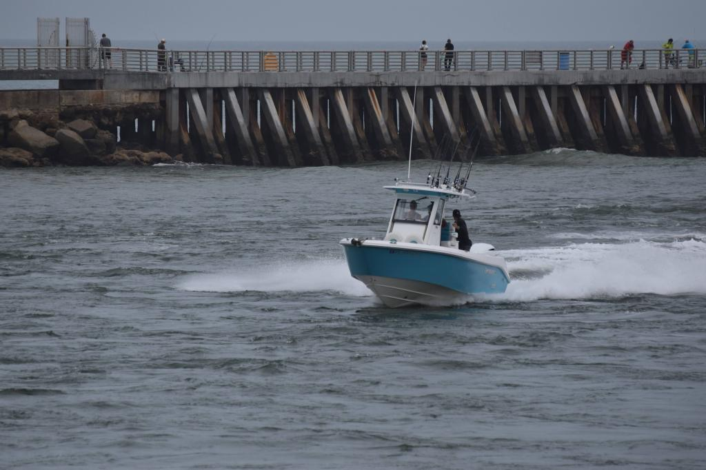 Fishing boat coming through the Sebastian Inlet. The jetty in Sebastian Inlet is in the background